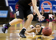 Benton's Daejah Bernard (4) looks up after falling onto the court as Dexter's Erika Cobb (15) steals the ball in Friday's Class 4 semifinal during the 2014 Show-Me Showdown at Mizzou Arena on March 21, 2014 in Columbia. (David Welker | Special to the News-Press)