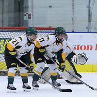 4th year forward Kylee Kupper (21) and 4th year defender Jolene Kirkpatrick (11) of the Regina Cougars waiting for the puck drop during the Women's Hockey Homeopener on October 7 at Co-operators arena. Credit: Arthur Ward/Arthur Images