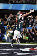 New England Patriots tight end Rob Gronkowski (87) jumps and catches a 4 yard touchdown pass good for a 33-32 fourth quarter Patriots lead while covered by Philadelphia Eagles cornerback Ronald Darby (41) during the 2018 NFL Super Bowl LII football game against the Philadelphia Eagles on Sunday, Feb. 4, 2018 in Minneapolis. The Eagles won the game 41-33. (©Paul Anthony Spinelli)