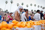 Finishing runners pick up oranges and other replenishing snack at the finish line.