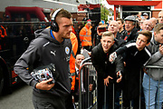 Jamie Vardy (9) of Leicester City gets off the team bus wearing Beats headphones on arrival for the Premier League match between Bournemouth and Leicester City at the Vitality Stadium, Bournemouth, England on 30 September 2017. Photo by Graham Hunt.