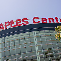 Photo of the Staples Center sign in downtown Los Angeles, California. The Staples Center is an arena that hosts sports, concerts and other entertainment events. Staples Center is home to the NBA Los Angeles Lakers and Los Angeles Clippers professional basketball teams. Photo is high resolution and was taken in 2012.