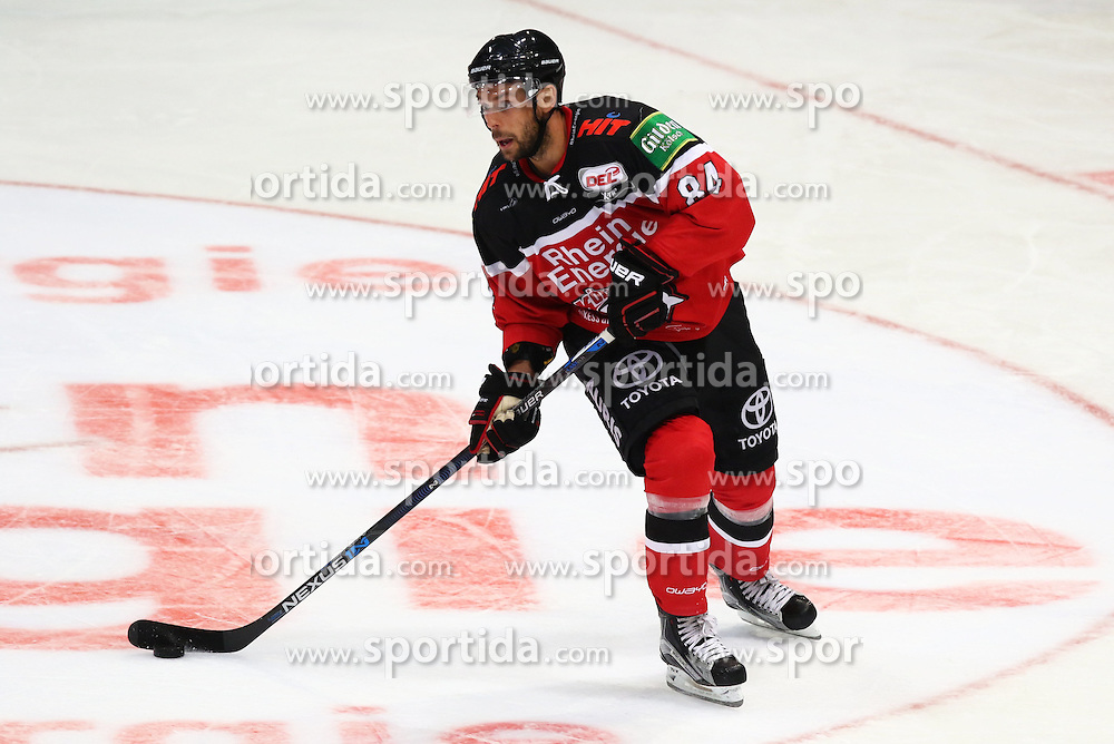 11.09.2015, Lanxess Arena, Koeln, GER, DEL, Koelner Haie vs EHC Red Bull Muenchen, 1. Runde, im Bild Dragan Umicevic (Koeln) am Puck // during the German DEL Icehockey League 1st round match between Koelner Haie and EHC Red Bull Munich at the Lanxess Arena in Koeln, Germany on 2015/09/11. EXPA Pictures &copy; 2015, PhotoCredit: EXPA/ Eibner-Pressefoto/ Weiss<br /> <br /> *****ATTENTION - OUT of GER*****