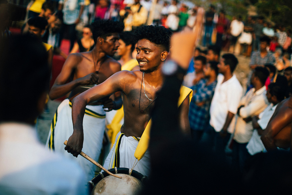 Fort Kochi, India -- February 11, 2018: University students play traditional music at a small festival at Mahatma Gandhi Beach.