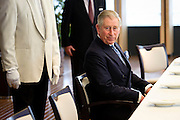 HRH Prince Charles of Wales sits at the table  prior to the meeting in the European Commission Headquarters  in  Brussels, Belgium on 2011-02-09   by Wiktor Dabkowski