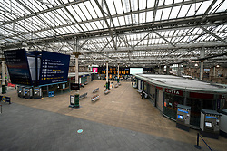 Edinburgh, Scotland, UK. 29 April 2020. Views of Edinburgh Old Town as coronavirus lockdown continues in Scotland. Streets remain deserted and shops and restaurants closed and many boarded up. Scottish Government now recommends public to wear face masks. Interior of an empty Waverley Station. Iain Masterton/Alamy Live News