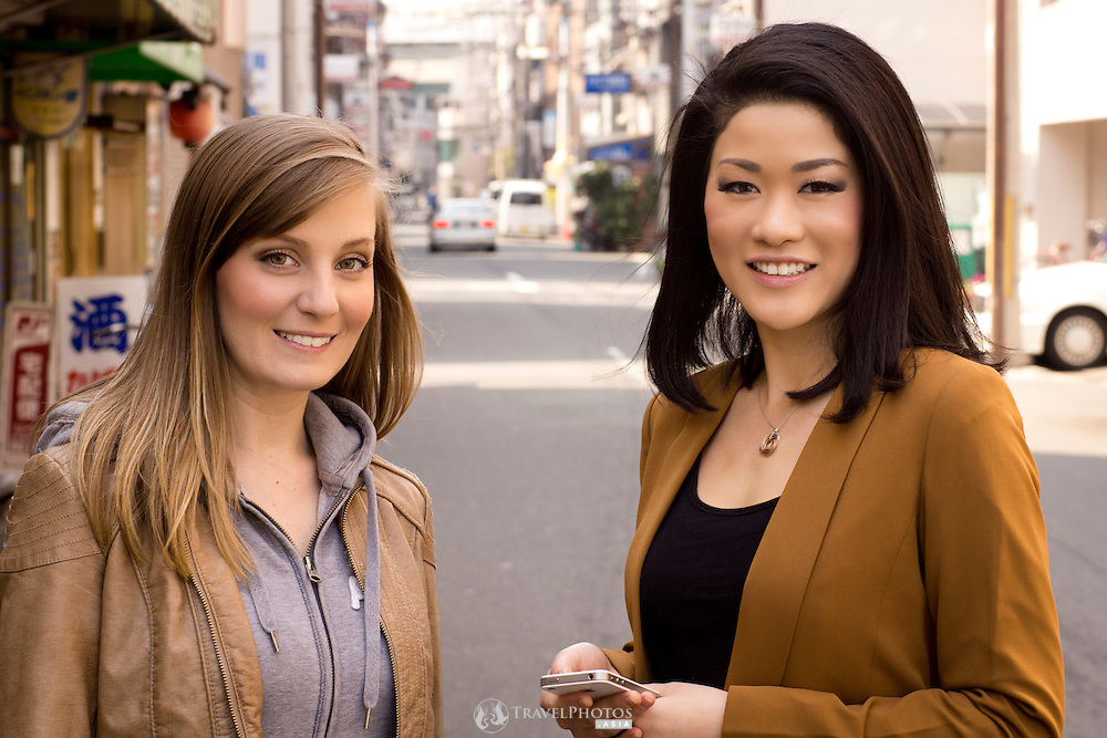 A caucasian and a Japanese woman in the streets of Osaka, Japan.