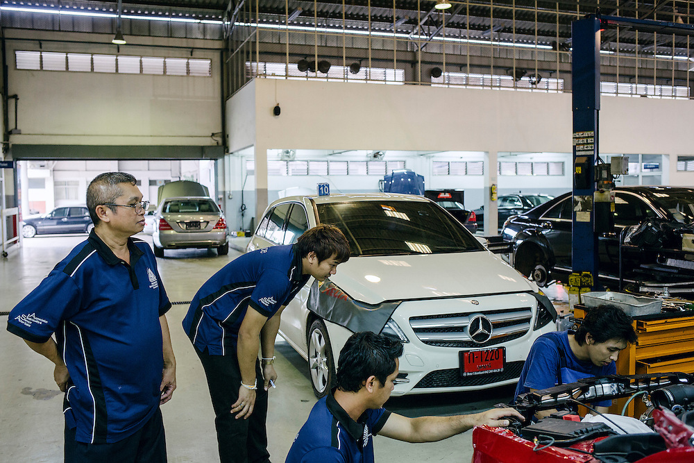 The Mercedes-Benz workshop for after sales service. Customers from Myanmar and Laos drive their cars across the border to get their cars serviced here because the Thai mechanics are better qualified. This Mercedes-Benz dealership has doubled in size in the last few years because of the economic boom in the North-East, one of the poorest rural regions of Thailand. Recent government policies have been beneficial for farmers and rural regions. Udon-Thani, Thailand. 2013
