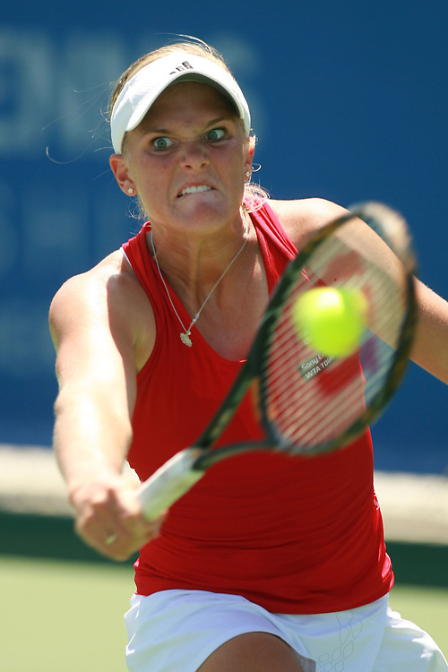 Aug 04, 2009 - Carson, California, USA - Aug 04, 2009 - Carson, California, USA - LA Tennis Champs WTA tournament. MELANIE OUDIN returns a ball against opponent D. Hantuchova in the LA Women's Tennis Championships played at the Home Depot Center. Hantuchova won the match 6-7 6-2 6-2(Credit Any Usage:ZUMAPRESS.com/Wally Nell)