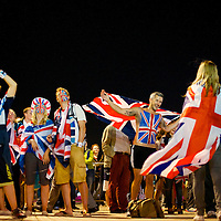 British fans cheer at the Olympic Park in front of television studios during the 2012 London Summer Olympics.