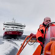 Three weeks aboard the Kong Harald. Hurtigruten, the Coastal Express. People in MOB (Man Over Board) suits.