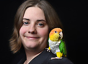 "Photo by Mara Lavitt -- Special to the Hartford Courant<br /> March 21, 2015, Middletown<br /> The eighth FeatherFest was held in Middletown by the Connecticut Parrot Society providing visitors with education about parrots and other birds. Jessica El-Beck of Meriden with her white-bellied caique named Zeke. El-Beck adopted Zeke through the CT Parrot Society's adoption program. ""I have a tattoo of Zeke on my leg. He's holding a banner that says 'Adopt'""."