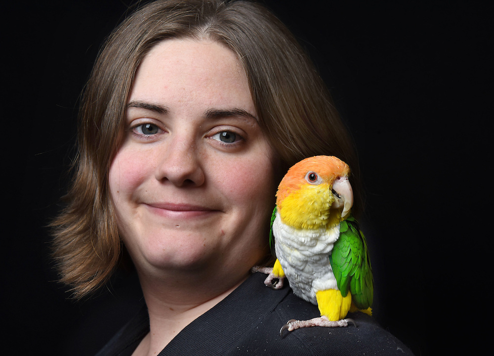 Photo by Mara Lavitt -- Special to the Hartford Courant<br /> March 21, 2015, Middletown<br /> The eighth FeatherFest was held in Middletown by the Connecticut Parrot Society providing visitors with education about parrots and other birds. Jessica El-Beck of Meriden with her white-bellied caique named Zeke. El-Beck adopted Zeke through the CT Parrot Society's adoption program. &quot;I have a tattoo of Zeke on my leg. He's holding a banner that says 'Adopt'&quot;.