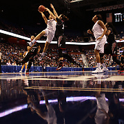 Gabby Williams, UConn, drives tot he basket during the UConn Vs Cincinnati Quarterfinal Basketball game at the American Women's College Basketball Championships 2015 at Mohegan Sun Arena, Uncasville, Connecticut, USA. 7th March 2015. Photo Tim Clayton