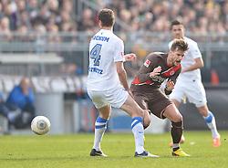 Football: Germany, 2. Bundesliga, 15.02.2014<br />Marcel Maltritz (VfL Bochum, #4) fouls Christopher Noethe (FC St. Pauli, #9)<br />?? pixathlon