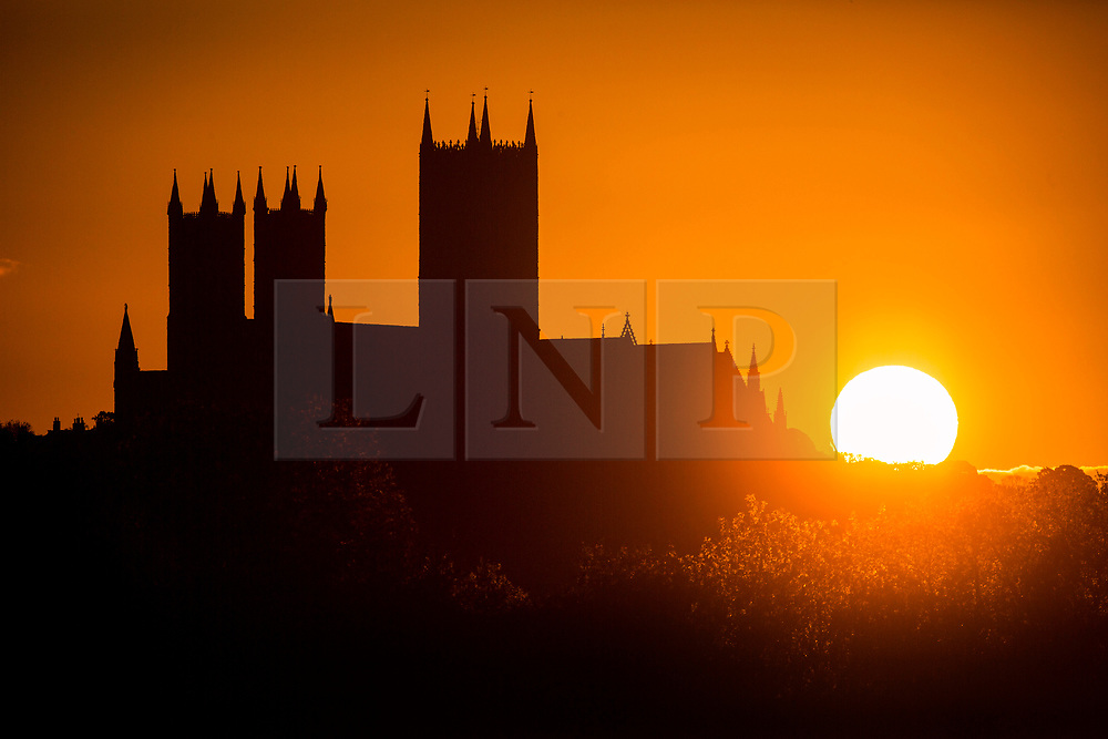 © Licensed to London News Pictures. 14/05/2020. Lincoln UK. The sun rises this morning next to Lincoln Cathedral in Lincolnshire as the UK looks forward to more fine weather. Work started on the Cathedral in 1072 & for 238 years it was the tallest building in the world. Photo credit: Andrew McCaren/LNP