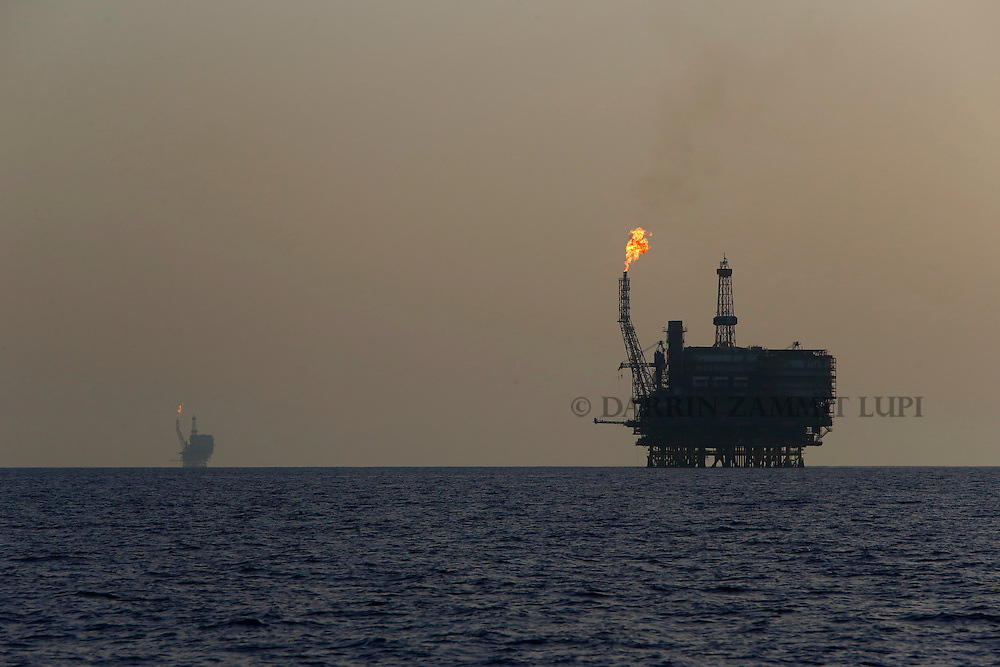 Offshore oil platforms are seen at the Bouri Oil Field off the coast of Libya August 3, 2015.  Oil prices lurched 5 percent lower on Monday to their lowest since January, taking global benchmark Brent below $50 a barrel as weak factory activity in China deepened a commodity-wide rout.<br /> REUTERS/Darrin Zammit Lupi <br /> MALTA OUT. NO COMMERCIAL OR EDITORIAL SALES IN MALTA