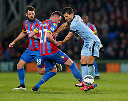 Sergio Aguero of Manchester City is tackled by Damien Delaney of Crystal Palace - Photo mandatory by-line: Rogan Thomson/JMP - 07966 386802 - 06/04/2015 - SPORT - FOOTBALL - London, England - Selhurst Park - Crystal Palace v Manchester City - Barclays Premier League.
