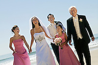 Happy Bride and Groom With Family on Beach