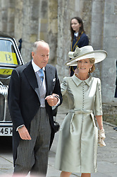 Lord and Lady Brabourne at the wedding of the Hon.Alexandra Knatchbull to Thomas Hooper held at Romsey Abbey, Romsey, Hampshire on 25th June 2016