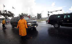29 August 2007. Lower 9th Ward, New Orleans, Louisiana. <br /> Second anniversary of Hurricane Katrina. President Bush's convoy speeds past the Hurricane Katrina Memorial in the pouring rain. (Bush silhouetted in car window) He did not stop to meet residents who gathered at the hurricane Katrina memorial in the Lower 9th Ward to remember those who perished when the industrial canal levee breached less than a mile from where they stand. Many residents are struggling to return to the still derelict and decimated Lower 9th Ward.<br /> Photo credit©; Charlie Varley/varleypix.com
