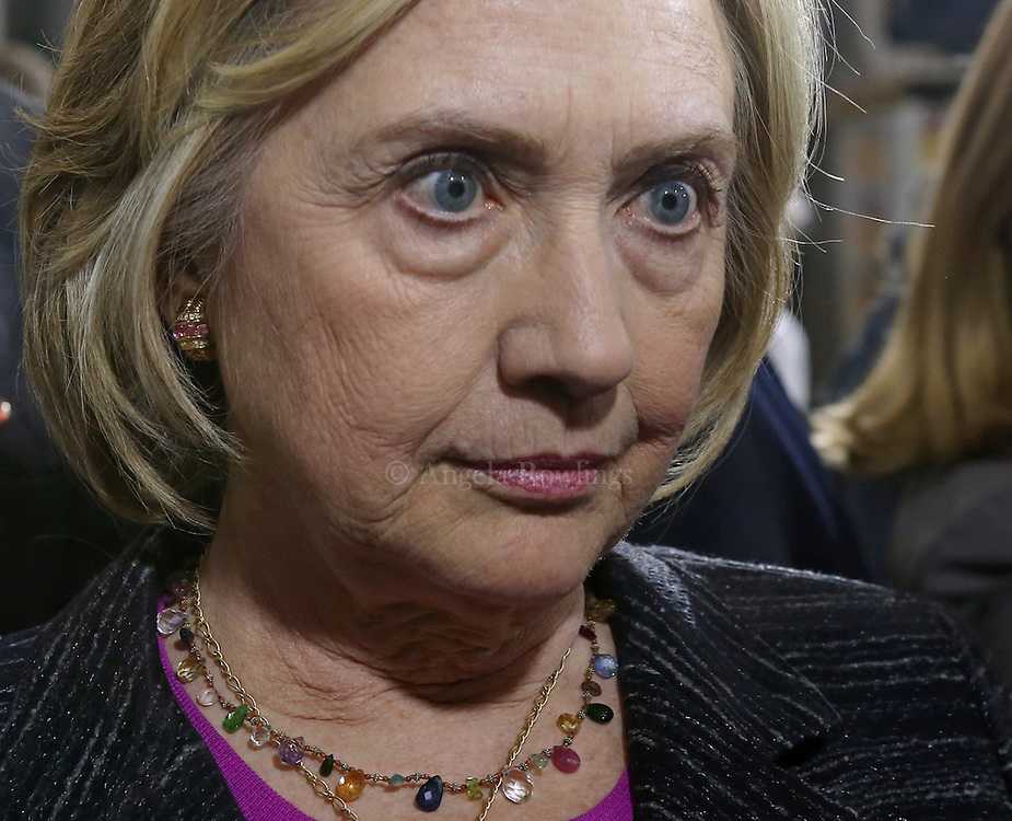 (Hampton, NH - 5/22/15) Former Secretary of State and presidential candidate Hillary Clinton listens to a reporter's question about her newly released emails following an event at Smuttynose Brewery, Friday, May 22, 2015. Staff photo by Angela Rowlings.