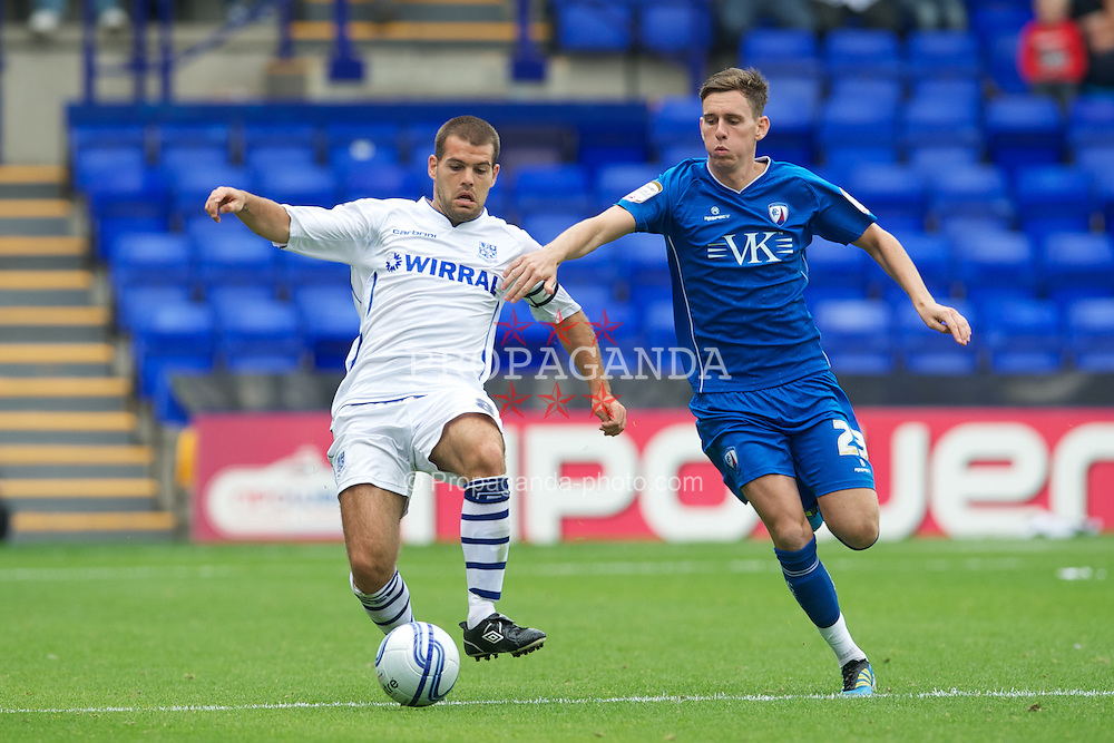 BIRKENHEAD, ENGLAND - Saturday, August 6, 2011: Tranmere Rovers' captain John Welsh, making his 100th start for the club, in action against Chesterfield during the opening Football League One match at Prenton Park. (Photo by David Rawcliffe/Propaganda)