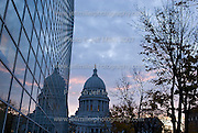 Passing clouds at sunset provide a backdrop for the dome of the Wisconsin State Capitol in downtown Madison, Wis., on Nov. 8, 2007. At left is the glass side of the US Bank building a 1 S. Pinckney Street..Photo © Jeff Miller 2007 - all rights reserved.www.jeffmillerphotography.com  ?  608-250-2374.Date: 11/07   File#: NIKON D200 digital camera frame 5316