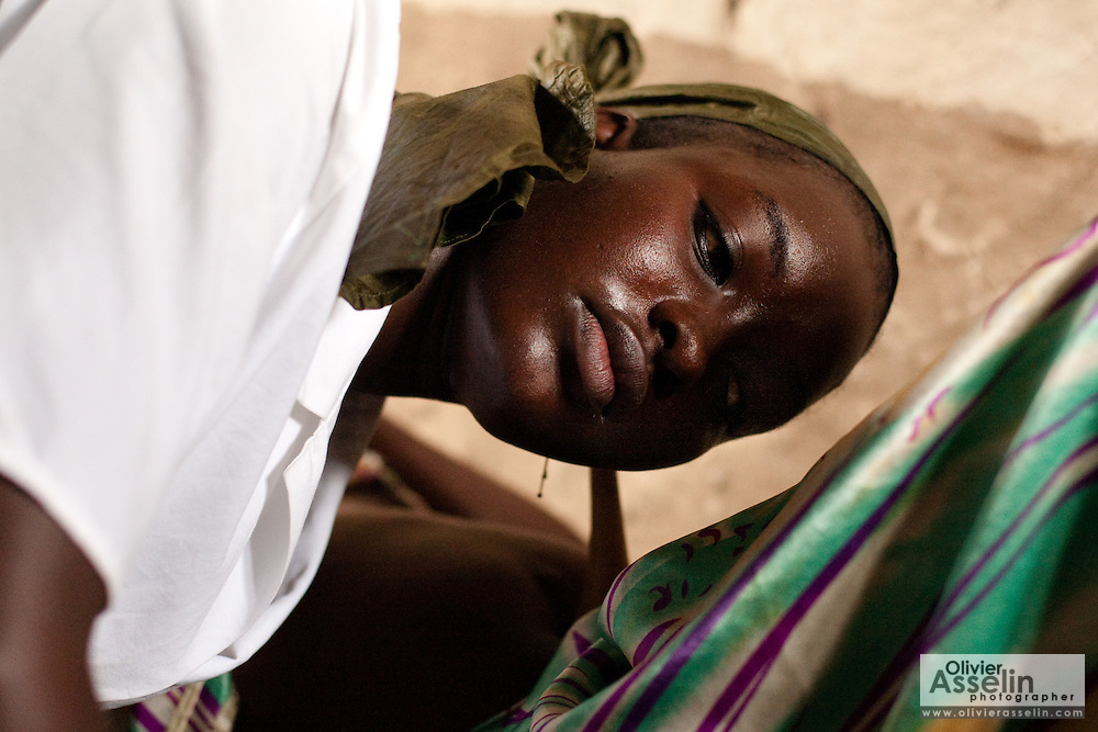 Nurse Maba N'Djim listens for heartbeat on the belly of Kegneba Diakite, 28, 6 mo pregnant, during a prenatal consultation in the village of Banankoro, Mali on Saturday August 28, 2010..