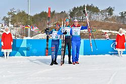 DAVIET Benjamin FRA LW2, REPTYUKH Ihor UKR LW8, OLSRUD Hakon NOR LW8 competing in the ParaSkiDeFond, Para Nordic Skiing, 20km at  the PyeongChang2018 Winter Paralympic Games, South Korea.