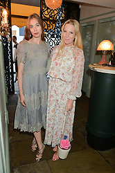 Left to right, ANOUSKA BECKWITH and ALICE NAYLOR-LEYLAND at a dinner hosted by Kate Spade NY to celebrate Chelsea in Bloom held at Daphne's, 112 Draycott Avenue, London on 20th May 2015.