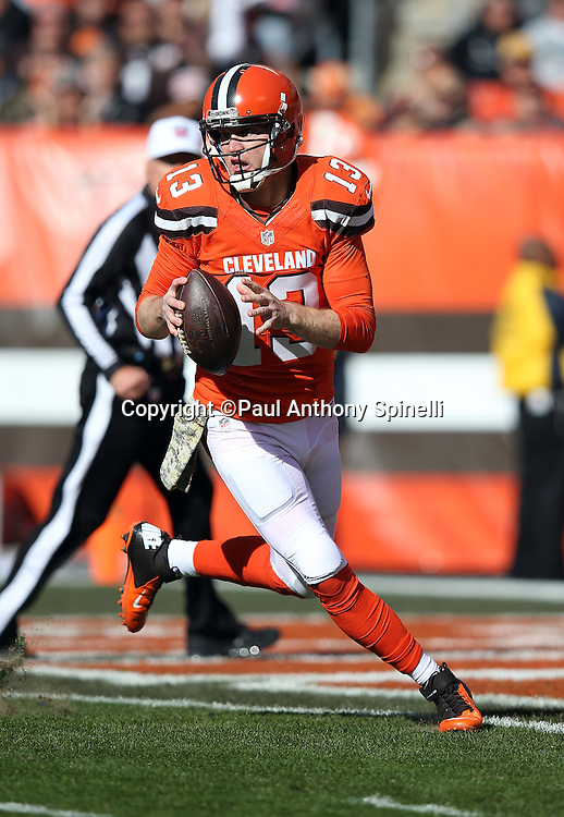 Cleveland Browns quarterback Josh McCown (13) scrambles while looking to pass from his own end zone during the 2015 week 8 regular season NFL football game against the Arizona Cardinals on Sunday, Nov. 1, 2015 in Cleveland. The Cardinals won the game 34-20. (©Paul Anthony Spinelli)