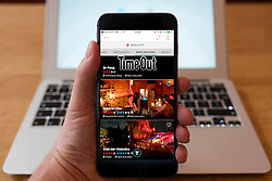 Using iPhone smartphone to display homepage of TimeOut Berlin edition