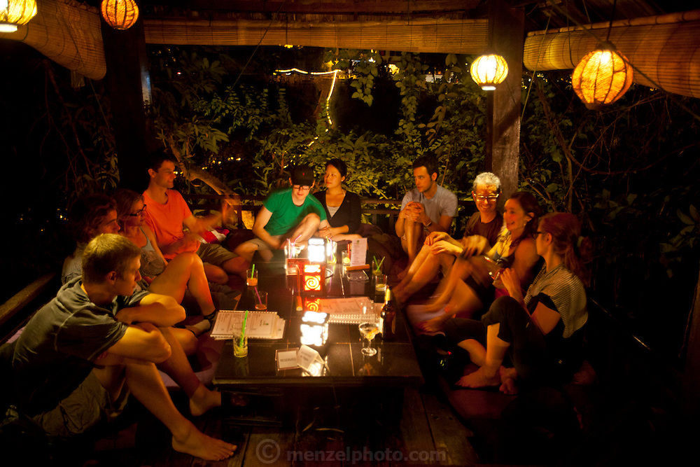 Family dinner for Menzel/D'Aluisios at Dyen Sabai Restaurant on the Nam Khan River, Luang Prabang, Laos.