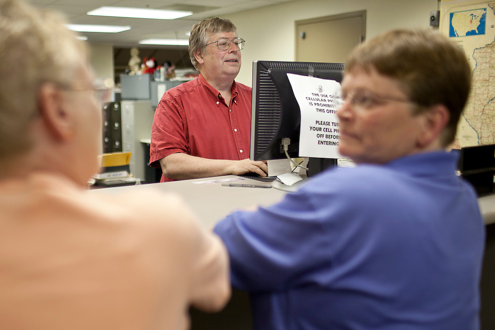 Macon County Clerk Steve Bean fills out paperwork for Linda Schroeder and Nancy Ryherd's civil union license at the Macon County Office Building just after 12 midnight Wednesday, June 1, 2011, in Decatur, Ill. (Stephen Haas)