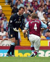 Photograph: Scott Heavey.<br />Aston Villa V Liverpool. FA Barclaycard Premiership match from Villa Park. 24/08/2003.<br />Thomas Sorensen vents his anger at his own defender, Olof Mellberg.
