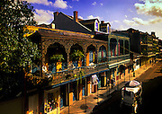 Horse drawn carriage rides down Royal Street and past its colorful and decorative architecture, so prevelant in the French Quarter of New Orleans.