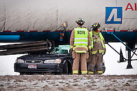 JEROME A. POLLOS/Press..Kootenai County firefighters wait to clear the scene of an accident in the eastbound lanes of Interstate-90 near Highway 41 following a short, but havoc-causing freezing rainfall that caused dozens of wrecks Tuesday between Stateline and Coeur d'Alene.