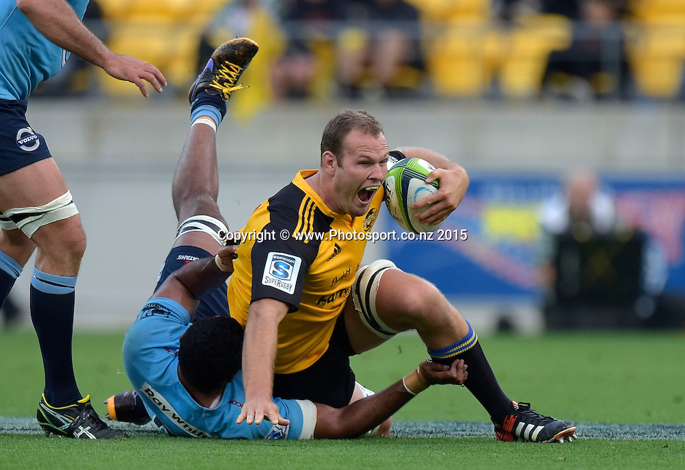 Hurricanes' lock James Broardhurst (Top) is tackled by Waratahs' Wycliff Palu during the Super Rugby - Hurricanes v Waratahs rugby union match at the Westpac Stadium in Wellington on Saturday the 18th of April 2015. Photo by Marty Melville / www.Photosport.co.nz