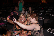 A group of women take a selfie