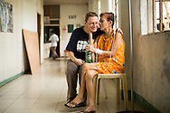 CLIENT: PROJECT HOPE<br /> <br /> Project HOPE volunteer Carma Erickson-Hurt visits with cancer patient Elenita Capulso, 84, in a hallway of Tapaz District Hospital on Panay Island, Philippines.  Erickson-Hurt has been visiting Capulso every day in the hospital. &quot;You are the first people who cared,&quot; said Capulso.