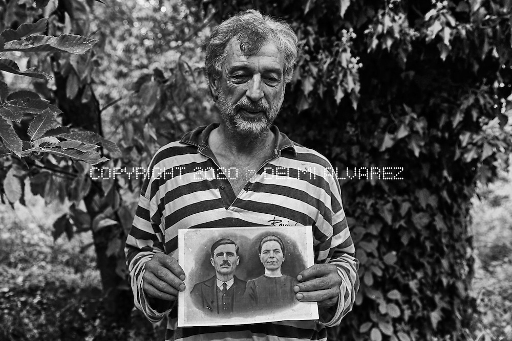 Giorgios hold a portrait of his relatives that lived in the farm for many years. His farm near the Mine of Skouries in Greece. He had been living under pressure because the gold mine and now he is sad to think that one day all this forest and valleys will be contaminated by the poison of the gold mine of Eldorado Gold mine company.