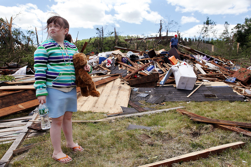 (060211  Monson, MA) Carleigh Esposito, 7, holds a stuffed animal by her flattened home on Washington Street in Monson as her dad, Anthony, searches for belongings, Thursday,  June 02, 2011.  Staff photo by Angela Rowlings.