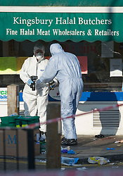 © London News Pictures. 19/11/2011. Police forensics examine evidence outside Kingsbury Halal Butchers on Kingsbury Road, North West London the scene where four police officers where stabbed early this morning (19/11/2011). A man attacked the police officers with a knife he grabbed from the butchers shop after he had been chased by the police. Photo credit : Ben Cawthra/LNP