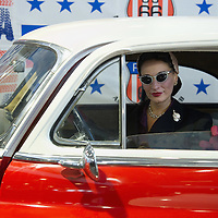 PADOVA, ITALY - OCTOBER 27:  A model wearing vintage style dress poses while sitting inside a classic American car on October 27, 2011 in Padova, Italy. The Vintage and Classic Cars Exhibition of Padova, running from the October 28 - 30, is the most important European trade show for vintage cars and motorbikes, showcasing over 1600 vehicles.