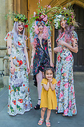 A young fan - British couturier to royalty, Catherine Walker & Co. stages a showcase of its designs to pay tribute to the RHS Chelsea Flower Show and celebrate its 40th anniversary. Models were dressed in Spring Summer couture, complemented by floral and butterfly head dresses and make-up.   A ruby butterfly pendant to mark 40 years was also revealed. Carole Middleton wore Catherine Walker & Co at the wedding of her daughter Pippa on Saturday (and at the Royal Wedding of the Duke and Duchess of Cambridge) and over half of the dresses on display at Kensington Palace's Diana: Her Fashion Story are by the House.<br /> St Lukes Church, Chelsea, London 25th May 2017.