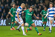 Queens Park Rangers defender Toni Leistner (37) challenges Sheffield Wednesday forward Jordan Rhodes (6) during the The FA Cup match between Queens Park Rangers and Sheffield Wednesday at the Kiyan Prince Foundation Stadium, London, England on 24 January 2020.