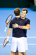 Andy Murray of Great Britain and Jamie Murray of Great Britain celebrate victory over Argentina in the doubles during the 2016 Davis Cup Semi Final between Great Britain and Argentina at the Emirates Arena, Glasgow, United Kingdom on 17 September 2016. Photo by Craig Doyle.