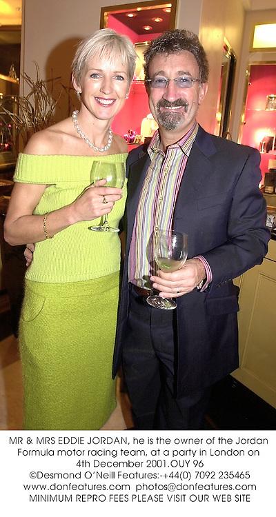 MR & MRS EDDIE JORDAN, he is the owner of the Jordan Formula motor racing team, at a party in London on 4th December 2001.OUY 96