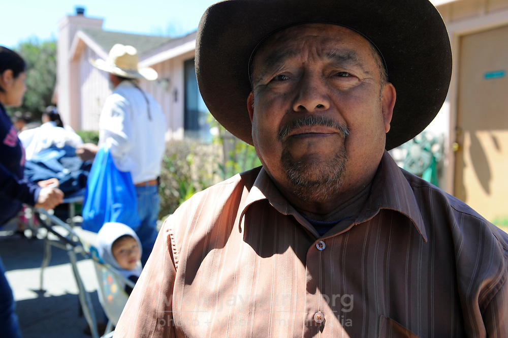 Tereso Zarate, 68, is a field worker from Oaxaca, Mexico who has lived in Salinas for ten years. He cannot subsist solely on seasonal work as a lettuce-picker. A Monterey County Food Bank distribution program in the Hebbron neighborhood where he lives is crucial to making it through the winter.